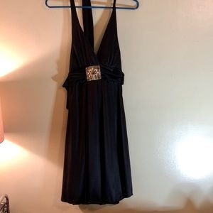 Black halter dress with silver broach detail